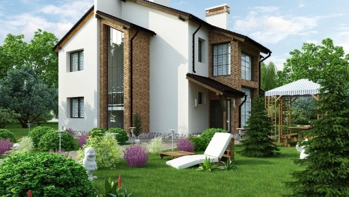 Красивый проект двухэтажного загородного коттеджа с оригинальной крышей